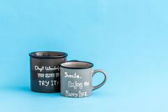 Creative, Cute Coffee Mugs on Blue Background Royalty Free Stock Photo
