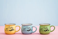 Creative, Cute Coffee Mugs on Blue, Pink Background Stock Photo