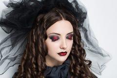 Woman black veil royalty free stock photography