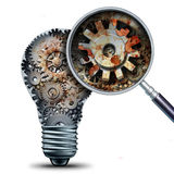 Creative Decline. And outdated and obsolete ideas concept as a lightbulb made of mechanical gears with a magnigying glass showing a closeup of rust and neglect Royalty Free Stock Photo