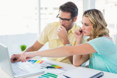 Creative design team during brainstorming working on laptop Royalty Free Stock Photo