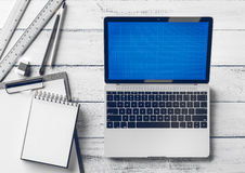 Creative designer and architect desktop with laptop and stationery items. Mock up. Stock Images