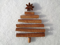 Creative, designer Christmas tree on snowy background. Stock Photo
