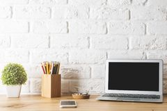 Creative designer desk with empty laptop royalty free stock image
