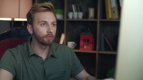 Creative designer drinking tea in startup office. Man looking on computer screen stock video footage