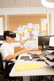 Creative designer experiencing vr glasses. Creative designer gesturing while experiencing vr glasses Royalty Free Stock Photography