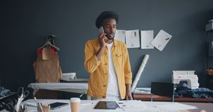 Creative designer making telephone call with smartphone talking at work stock footage