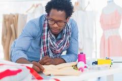 Creative designer measuring clothes Royalty Free Stock Photo