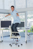 Creative designer surfing his swivel chair Stock Photos