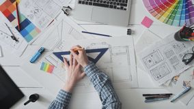 Creative designer working on a house plan. Stock footage stock video footage
