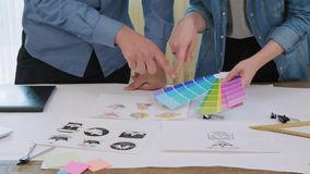 Creative designers picking a color for logo design. Creative designer working on a logo design stock footage stock footage