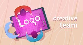 Creative Designers Team Working Sit At Desk Together Create Web Logo On Digital Tablet In Modern Office Top Angle View. Flat Vector Illustration Royalty Free Stock Images