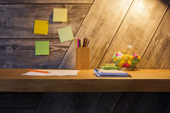Creative desk with stationery items Stock Photo