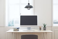 Creative desktop with blank pc. Close up of creative designer desktop with blank pc screen in white interior with window, city view and daylight. Mock up, 3D Stock Photo