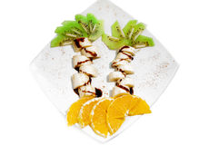 Creative  dessert  for child with banana, kiwi, orange. Royalty Free Stock Images