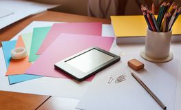 Work space table with office objects and ebook stock photos