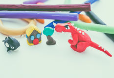 Creative dinosaur, whale, house and tree clay model. Play dough Stock Photo