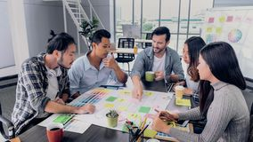 Creative director team lead brainstrom branding project with designer team at meeting table.discussion idea in creative office.  royalty free stock images