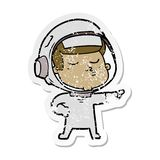 A creative distressed sticker of a cartoon confident astronaut. An original creative distressed sticker of a cartoon confident astronaut stock illustration