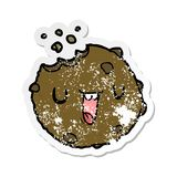 A creative distressed sticker of a cartoon cookie. An original creative distressed sticker of a cartoon cookie royalty free illustration