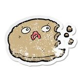 A creative distressed sticker of a cartoon cookie. An original creative distressed sticker of a cartoon cookie vector illustration