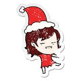 Hand drawn distressed sticker cartoon of a undead vampire girl wearing santa hat. A creative distressed sticker cartoon of a undead vampire girl wearing santa stock illustration