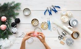 Creative diy hobby. Handmade christmas decoration, balls and garland. Making handmade christmas balls. Woman's leisure, tools for creating holiday decorations Royalty Free Stock Photo