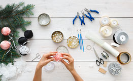 Creative diy hobby. Handmade christmas decoration, balls and garland Royalty Free Stock Photo