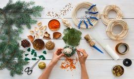 Creative diy hobby. Handmade craft christmas decoration, balls and garland Stock Image