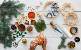 Creative diy hobby. Handmade craft christmas decoration, balls and garland Stock Images