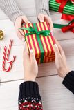 Gift wrapping. Packaging modern christmas present in boxes Stock Images