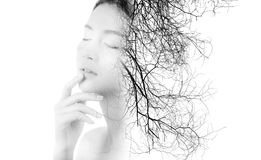 Creative double exposure of portrait beautiful fashion of woman isolated on white background. Silhouette of girl with branches of tree, environment concept Royalty Free Stock Photos