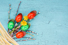 Creative Easter bouquet. Easter eggs, spoons, willow branch, lace, flowers. Top view, Easter background Royalty Free Stock Photos