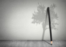 Creative ecology concept, pencil with shadow of tree Stock Photography
