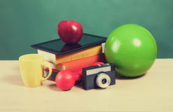 Creative education concept. Colorful school accessories on table. In classroom Stock Images