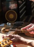 Luthier craftsman in home workshop royalty free stock photos