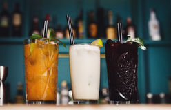 Creative exotic alcohol cocktails in night club bar Stock Photos
