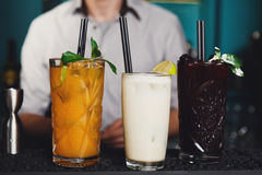 Creative exotic alcohol cocktails in night club bar Royalty Free Stock Photo
