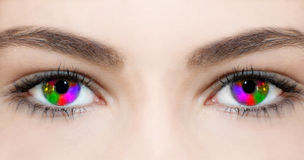 Creative Eye. Young woman with multicolored eye stock illustration