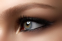 Creative eye makeup. Fashionable smoke eyes. Cosmetics and make- Royalty Free Stock Photo