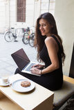 Creative female freelancer sitting front laptop computer with blank copy space screen for your information. Smiling young business woman work on net-book during Royalty Free Stock Image