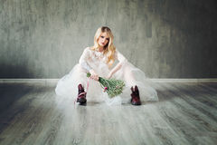 Creative Fiancee Woman Wearing White Dress. Sitting on a Parquet Floor. Fashion Model in White Bridal Gown Stock Images