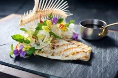 Creative fine dining fish dish. On slate Stock Photo