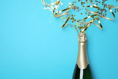 Creative flat lay composition with bottle of champagne and space for text. On color background stock photography