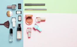 Creative flat lay of fashion bright nail polishes and decorative cosmetic on a colorful background. Minimal style. Copy royalty free stock images