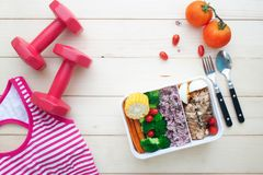 Creative flat lay of Nutrition lunch box, low calories and healthy ingredients. Sport and fitness concept with healthy food royalty free stock photography