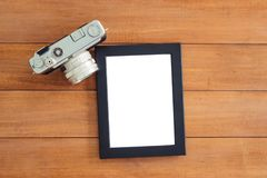 Creative flat lay photo of workspace desk. Office desk wooden table with old camera and poster mockup template. Top view with copy space. Top view of old stock images