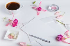 Creative flat lay photo of workspace desk with smartphone, coffee, pencil, flowers with copy space background. Flat lay royalty free stock photo
