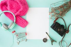 Creative flat lay with shopping cart, camera, La Tour Eiffel mod. El and headphones, Blank space for text, Top view Royalty Free Stock Images