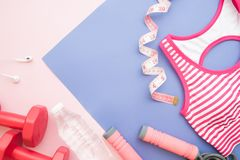 Creative flat lay sport, fitness and diet concept on pastel colo Stock Image